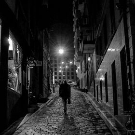 A late night passerby returns home on the one of the lane of Galata district, leading to the famous street Istiklal-kadessi  in Istanbul