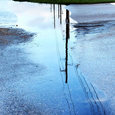 Puddle reflection of powerlines