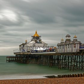 Eastbourne Pier, central to the seafront with its best surviving ironwork and little kiosks of the Victorian era, was opened by Lord Edward Caven...