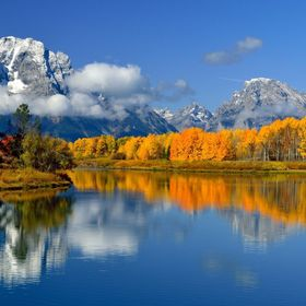 Autumn colors reflect into Oxbow bend along the Snake River below Mount Moran as the seasons change once again in Grand Teton National Park.  htt...