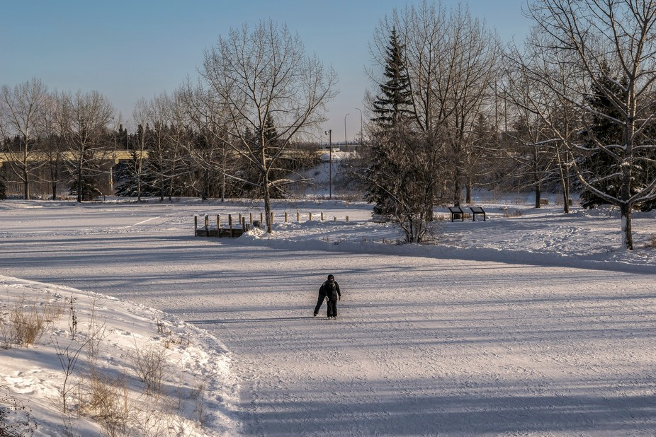 Skaters enjoying  the sunny but cold -30 C day on the ponds