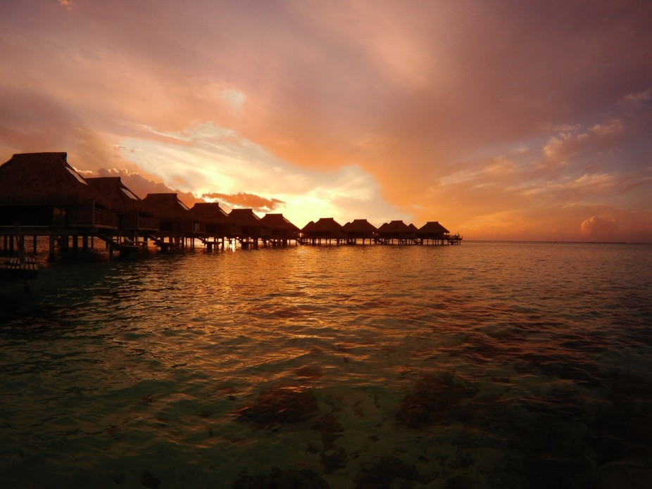 Sunset view from our over the water bungalow