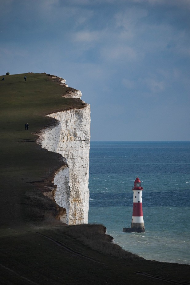 Lighthouse and cliffs by SteveCrampton - People In Large Areas Photo Contest