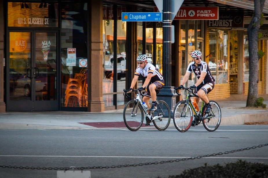 We were listening to our walk leader on walk instruction when these cyclists came around the Plaz...