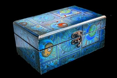 Blue wooden jewelry box isolated on black background