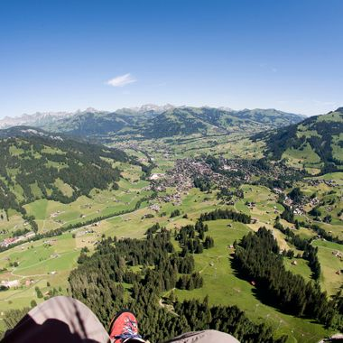 View during a nice Paragliding-Flight from the Mountain Wispile down to Gstaad. Bernese Oberland, Switzerland.