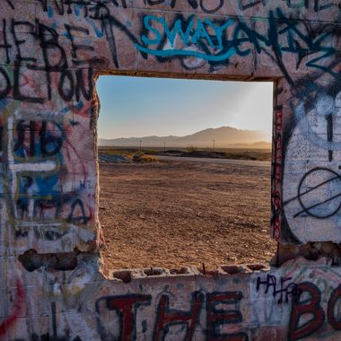 A framed view of the desert from ruins on old Hwy 66 near  Cadiz CA
