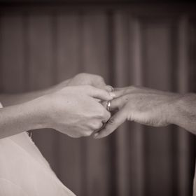 Probably my favorite picture I shot in this wedding. Bride putting on Groom's ring, in sepia and black and white twist