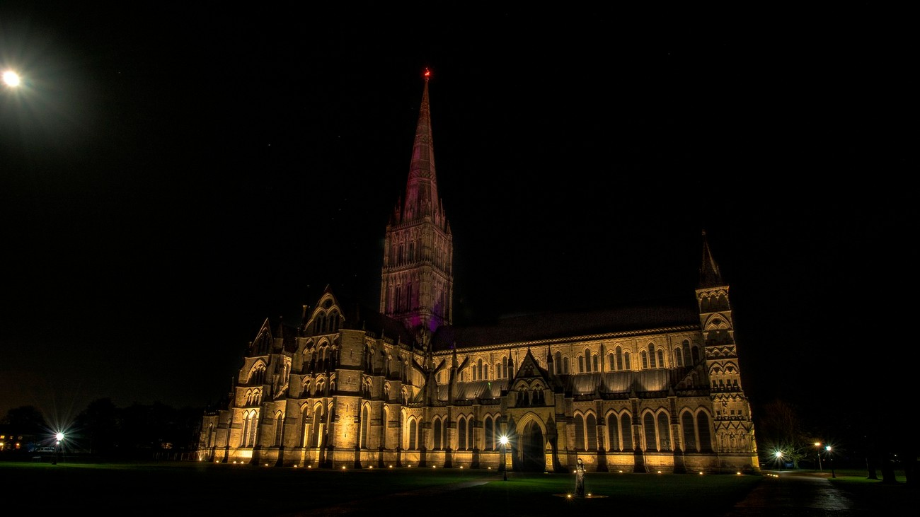 Salisbury cathedral is a magnificent structure dating from the 13th century AD.  At night the cathedral is lit up and the spire lights change color each night.