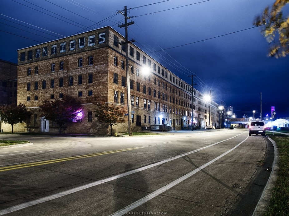 A wide shot of a very large brick building that houses several Antique stores.
