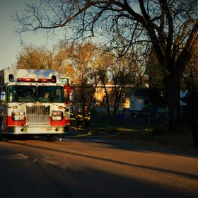 City fire department on scene of shed fire during late fall evening.