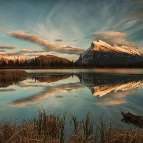 Mount Rundle is reflected on the Vermillion Lake
