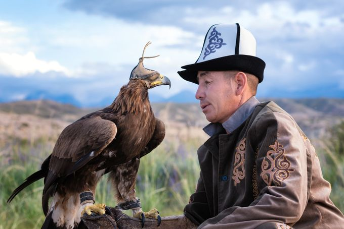 A Man Holds His Golden Eagle by Helen_Mountaniol - Hats Photo Contest