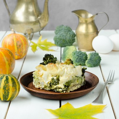 Healthy cabbage casserole at wooden table, still life