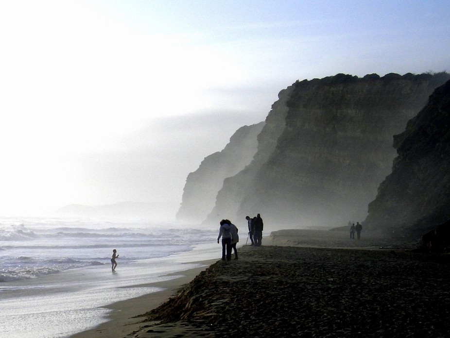 End of a winter day on the beach of Burgau, Algarve, Portugal