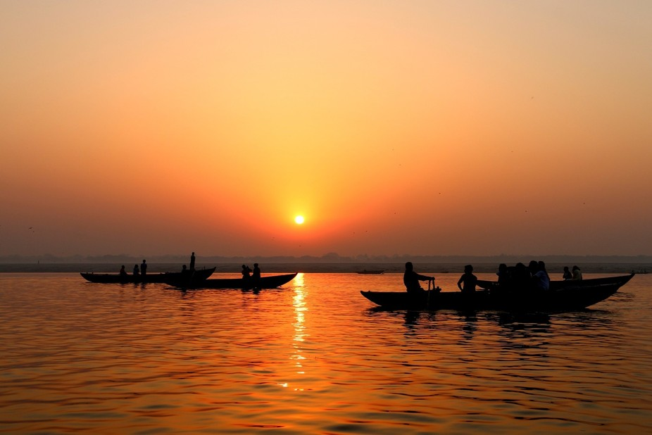 Watch the sunrise, start the day on a barge on the River Ganges in Varanasi in India