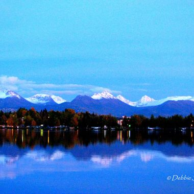 Photo taken from the Worlds Largest Seaplane base in Lake Hood, but the first sign of snow is always on the mountains and Flat Top is in the center of the photo with just a light dusting.