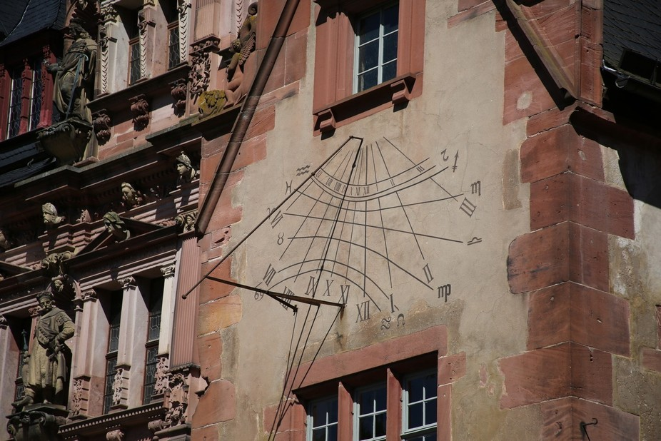 Sun clock on one of the buildings of the Heidelberg Castle compound.