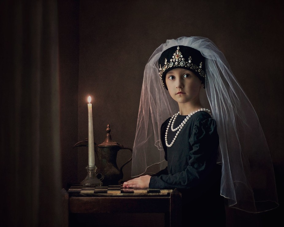 My six year old daughter.  I handcrafted the headpiece.. natural chiaroscuro lighting, setting in...