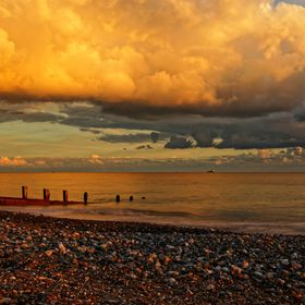 Worthing is a small costal town in West Sussex, England, The weather was perfect for seascape photography. The colours of the sky and the clouds ...