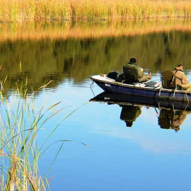 Fishing on the Norfolk Broads, UK.