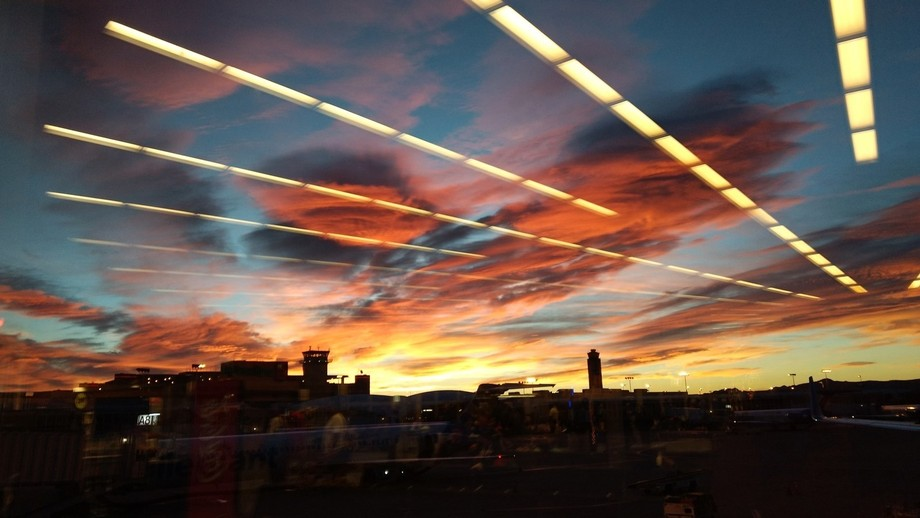 Early morning sunrise was brilliant, with contrasting airport terminal lights - leaving Las Vegas...