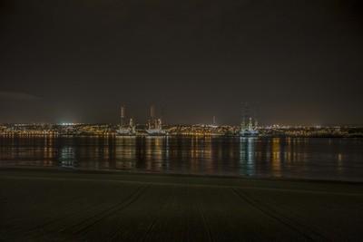 Three Rigs At Night