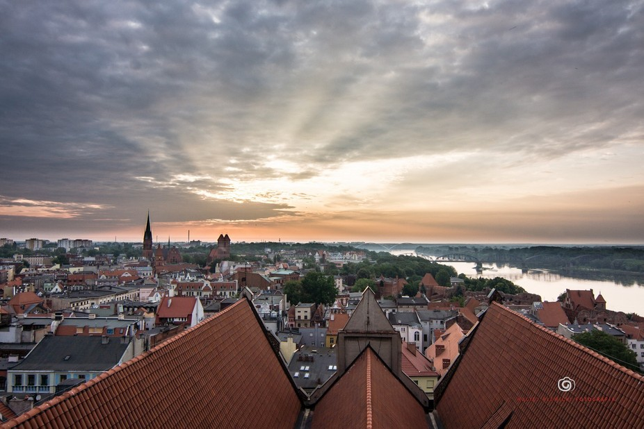 The sunrise over Torun from the catherdal