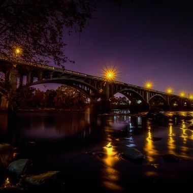 View of the Gervais Street Bridge from the West Columbia side of the Congaree River with the lights of Columbia, South Carolina in the background.