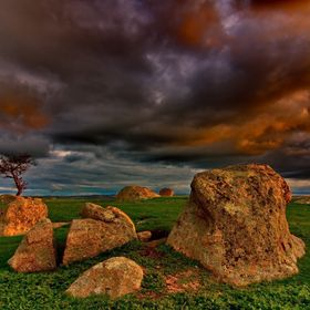 The setting Winter sun reflects on a threatening storm over Dog Rocks, near Geelong.