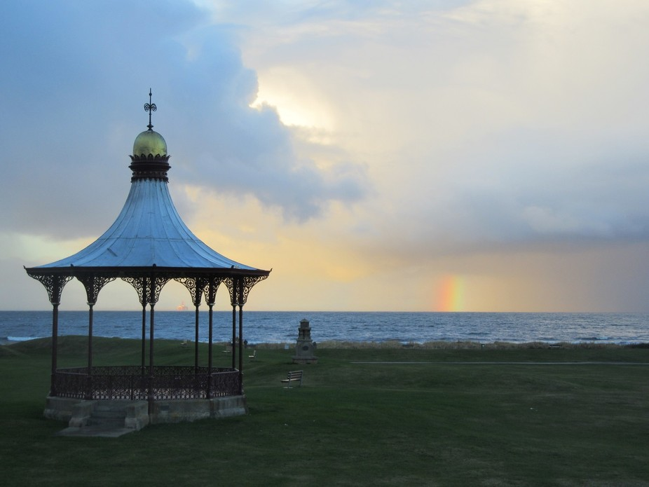 Gazebo and the rainbow by the sea