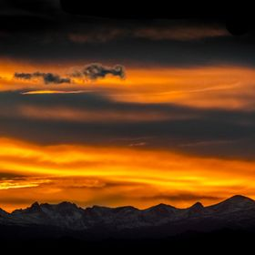 This is a beautiful sunset behind the Indian Peaks Wilderness in the Colorado Rocky Mountains.