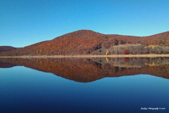 This was taken with my Samsung Galaxy phone while fishing on the Kinzua Reservoir on November 7.  Unfortunately I did not have my Nikon D5100 with me on this trip.  Enhanced and resized using Photoshop Elements 14.1. Some interesting things that have been observed on this photo.  If you rotate it counterclockwise it looks like the outline of a woman.  The grayish area in the right center looks a bit like a fish.