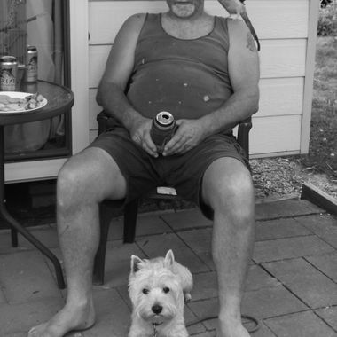 We were on holidays, with our furred and feathered kids, Stephen was having a cold beer on the verandah, it was just so natural I had to take it  :)