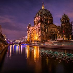 View of the Berliner Dom. The green trails in the river are a boat passing by in long exposure