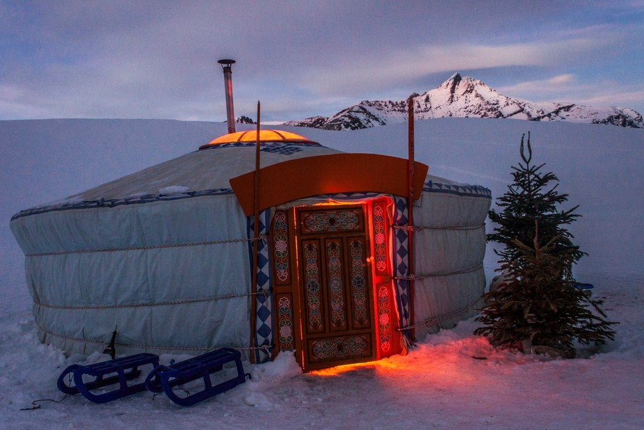 A yurt with the Tsanteleina mountain in the background. Spend a warm and cozy evening in a mind b...