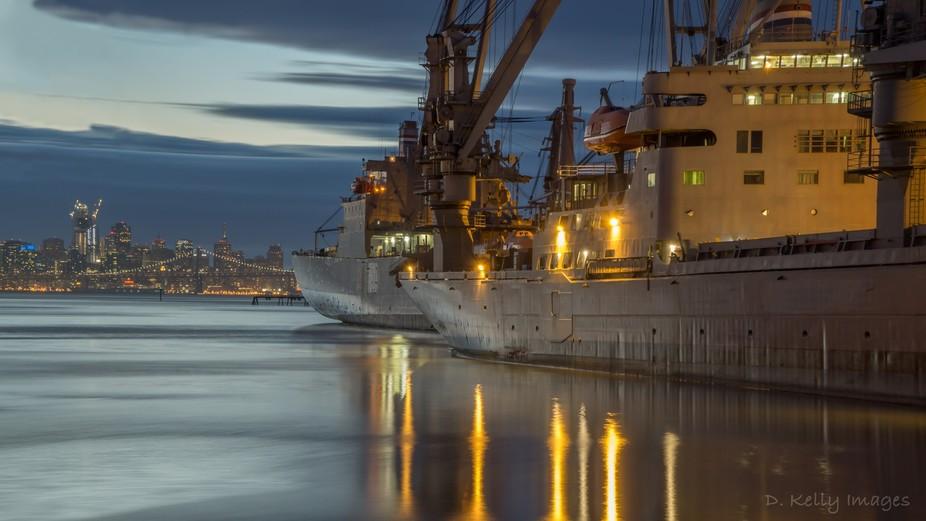 Docked ships at the Alameda Naval Base with San Francisco as a backdrop.