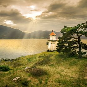 lighthouse and sun in norway