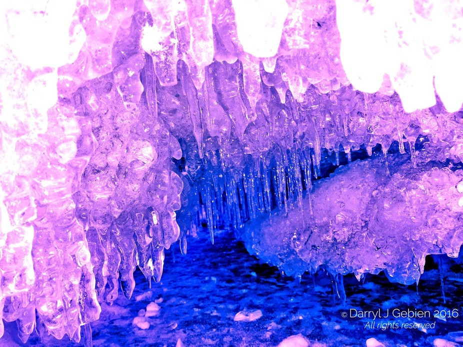 Small ice cave found near southern shore of Lake Simcoe in Barrie, ON.  Filters used.