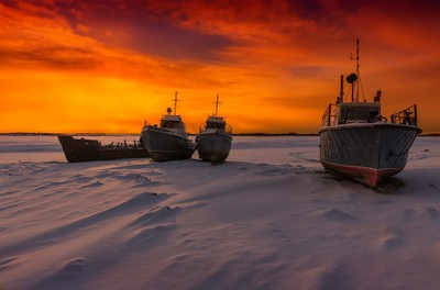 ships in the ice at sunset