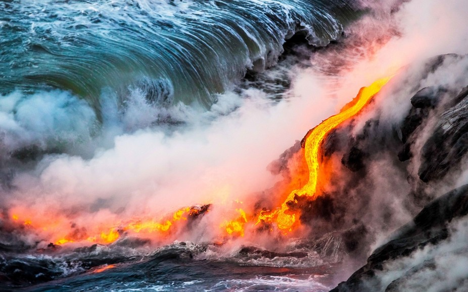 Lava ocean entry from the 2016 Kalapana lava flow on the Big Island of Hawaii. Watching new earth...