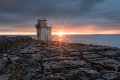 Sunset at the Black Head lighthouse (Ireland).