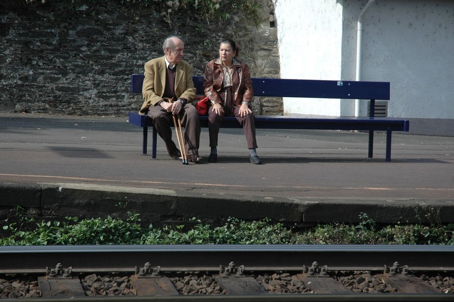 vacation in Germany waiting for a train when I saw this well dressed German couple across the tra...