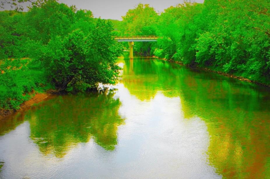 Green reflection on tis river in Zoar Ohio