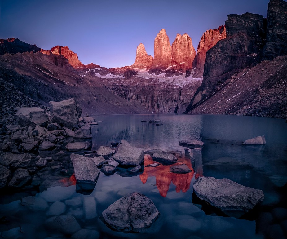 The beautiful towers of Torres Del Paine Park, in Chile, catching the light of the rising sun. Su...