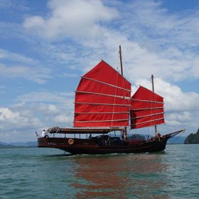 Chinese Junk Ship called the June Bahtra exploring the Andaman sea through the Ao Phang-Nga National Marine Park just off the coast of Phuket in ...