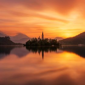 Beautiful sunrise at Lake Bled.  Long exposure created with 150 pictures from the following timelapse :   https://youtu.be/WYlbunrdweQ  Slovenia ...