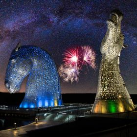 a composite shot of the Kelpies, some fireworks, and a milky way panorama.
