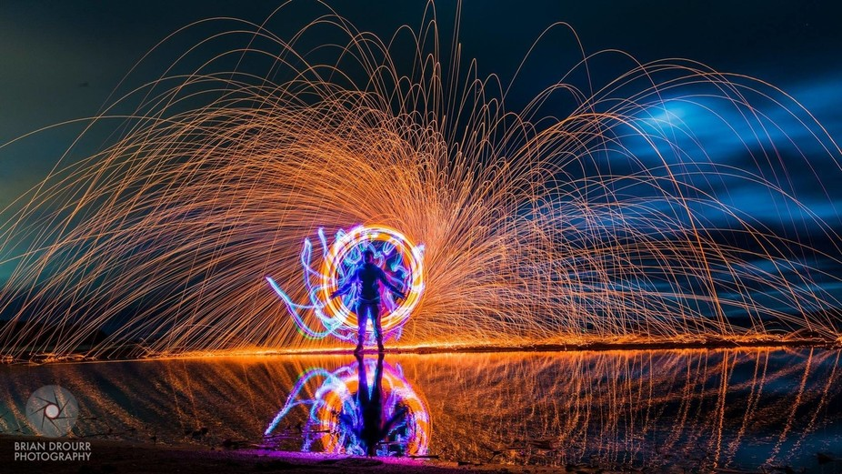 steel wool spinning and LED light painting. Single 104 second exposure.