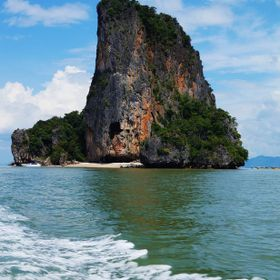 Huge limestone tower in the Ao Phang-Nga National Marine Park just off Phuket, Thailand.  The beach is a perfectly tranquil location for a spot o...